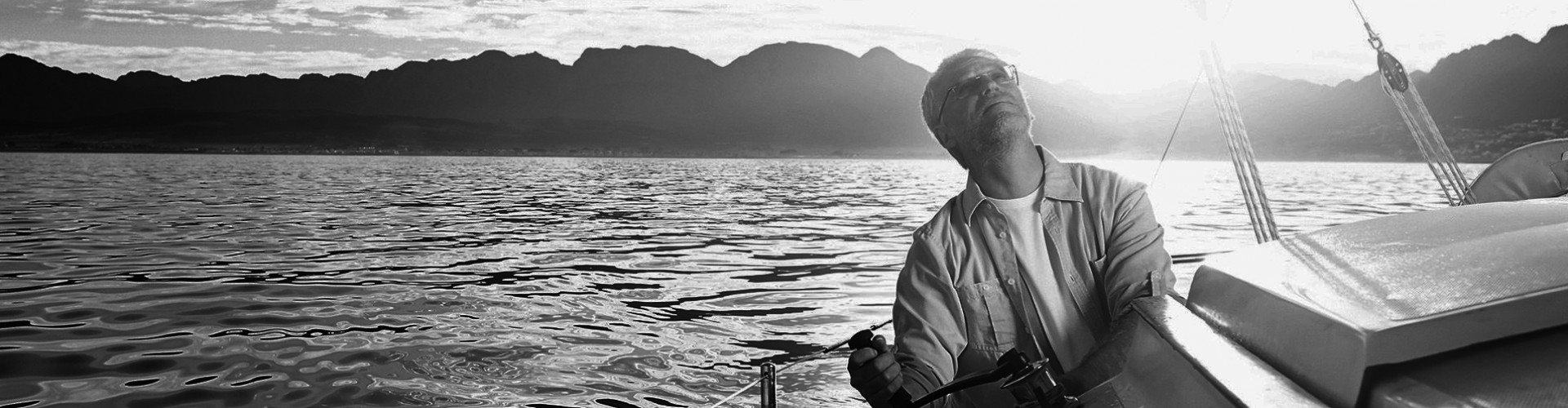 senior man on his sailboat